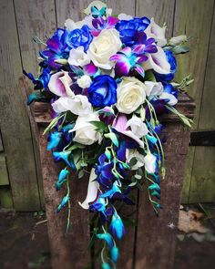Today's shower bouquet of #bluedendrobiumorchids #blueroses and #whiteavalancheroses #arundel #arundelflorist #westsussex #blueweddingflowers