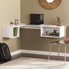 Work a sleek, contemporary look into any space with this corner convenient wall mount desk in a home office, living room, or open concept zone. Open up small space happiness with this fresh white floating desk. Storage cubbies wait for everything from books or tchotchkes to task lists and notebooks. Spacious display top doubles as a laptop work space or writing surface. Sit or stand at your desired height, or install as a bookcase or shelving unit wherever your heart desires.