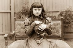 girl with a chicken...looks like she got her way to hold the bird for her formal pic. lol