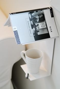love this cup and book holder. smart.