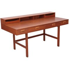 Danish Modern Flip-Top Desk in Teak by Peter Løvig Nielsen for Løvig, 1970s | From a unique collection of antique and modern desks and writing tables at https://www.1stdibs.com/furniture/tables/desks-writing-tables/