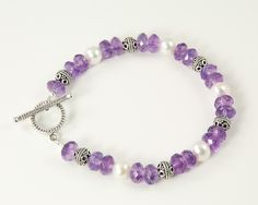 Amethyst and pearl bracelet in sterling silver, February birthstone jewelry, purple beaded bracelet, handmade jewelry. $58.00, via Etsy.