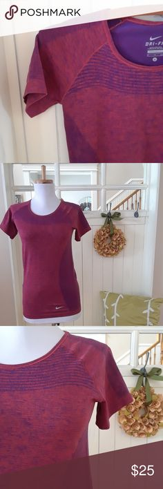 """NWOT! Raspberry Ombre Nike Dri-fit Tee Stylish & lightweight, let this raspberry colored ombre style Nike Dri-fit tee keep you comfortably cool during your next run or workout at the gym.  Features a scoop neck & stripes at neckine. Constructed from from 52% Polyester & 48% Nylon for stretch & comfort. 15.5"""" underarm to underarm 24"""" shoulder to hem. This has only been tried on & is in perfect condition. Nike Tops Tees - Short Sleeve"""
