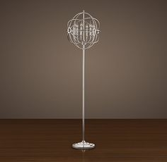 I had to have it. Restoration Hardware: Foucault's Iron Orb Floor Lamp Polished Nickel. Save link for replacement bulbs.