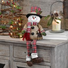 Welcome the season this December in rustic style with our Burlap Plaid Snowman Shelf Sitter. Fun accents make this a wonderful Christmas counter-space addition. Magical Christmas, Primitive Christmas, Christmas Snowman, Rustic Christmas, Christmas Time, Christmas Ornaments, Indoor Christmas Decorations, Snowman Decorations, Snowman Crafts