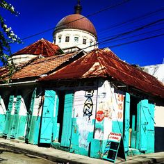 Many buildings in Cap-Haitien are painted in bright, beautiful colours. #GadvHaiti