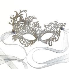Stunning Silver Renaissance Lace Masquerade Mask by Samantha Peach ($20) ❤ liked on Polyvore featuring costumes, silver halloween costume, peach halloween costume, white costumes, peach costume and renaissance costumes
