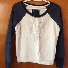 American Eagle Sweatshirt Thus American Eagle Sweatshirt is in excellent condition. It is a size X-Small with raglan sleeves American Eagle Outfitters Tops Sweatshirts & Hoodies