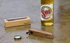 bottle-opener Sophisticated in its rustic simplicity. A magnetized bottle opener that you will find indispensable. One magnet catches the bottle cap; the other allows the bottle opener to be kept on the fridge.