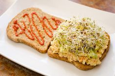 """""""Better Than Tuna"""" on toast with avocado slices, mixed sprouts and Sriracha hot sauce."""