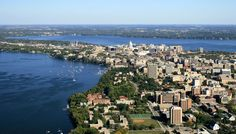 Madison, Wisconsin. The isthmus, including the University campus and sailing club on Lake Mendota (left), the capitol building and downtown (center) and Lake Monona (upper).