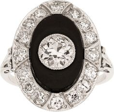 Art Deco Diamond, Black Onyx, Platinum Ring  The ring features a European-cut diamond measuring 6.20 x 6.20 x 3.90 mm and weighing approximately 1.00 carat, enhanced by full-cut diamonds weighing a total of approximately 0.70 carat, accented by an oval-shaped black onyx tablet, set in platinum.