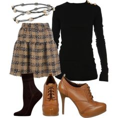 """Face it… every time we get dressed, we're being graded on our fashion. Why not score an """"easy A"""" in style with a look that gets high marks in anyone's grade book… For a consistently flattering shape, try an A-line skirt, like this pleated, tweed style paired with a sexy & sophisticated sweater. Put a tailored spin to your ensemble with a shootie & socks. Accessorize smartly, less is more!"""