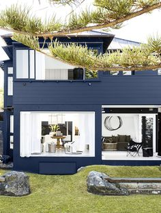 "This Sydney beach house is decorated with a beautiful minimalist style that proves that many times ""less is more"". The navy blue exterior of this house is Design Exterior, Exterior House Colors, Black Exterior, Turbulence Deco, Beach Shack, Facade House, Beach House Decor, Black House, Bungalows"