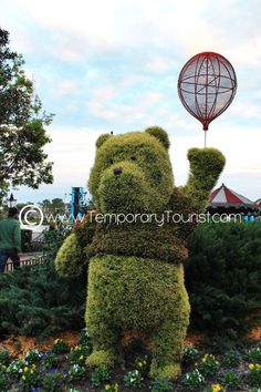 Winnie the Pooh Topiary During the International Flower and Garden Festival in Epcot at Walt Disney World - Epcot Florida, Topiary, Walt Disney World, Garden Sculpture, Flowers, Royal Icing Flowers, Flower, Florals, Floral
