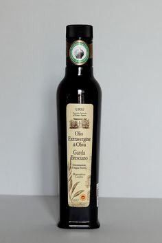 etichetta olio con foglie ulivo