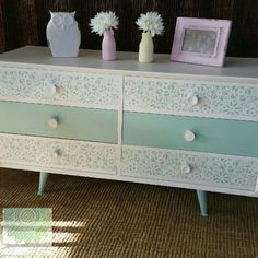 Retro low line drawers have been upcycled using Dixie Belle's Mineral Chalk Paints in Fluff and Sea Glass. the fronts have been completed in a stencil from one of Shomai Blooms personal designs.