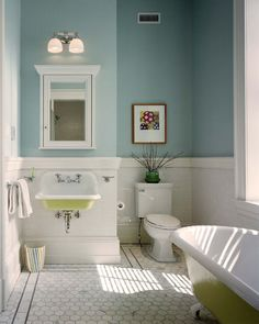 I like the large marble hex and simple border. There's the Kohler Brockaway sink and a tub with underside painted to match.