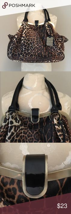 "Jessica Simpson Animal Print Handbag Beautiful Animal Print adorns this handbag. Black patent leather handles with metal locking closure. Lots of space on the outside including 2 side pockets, front and back snap closure pockets. Large interior space in main opening with a zippered pocket and 2 smaller open pockets. Overall this bag is in very good clean condition with some wear marks on the gold exterior metal frame. Measures 16"" in width, 11"" bag height and 8"" handles. Jessica Simpson Bags"