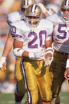 Greg Lewis of the Washington Huskies stands with teammates during a season games in september of 1989