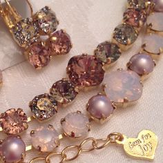 Pretty In pink shades of blush rose and rose water opal Swarovski crystal necklace and earring sets with the warm glow of gold toned settings!