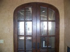 Wood and leaded glass arched interior doors - phoenix - Doors West Inc.