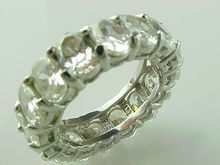 Vintage Sterling Silver 12 Carat Oval Synthetic Diamond Eternity Ring
