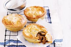This traditional beef and mushroom pies is infused with aromatic rosemary and garlic in shortcrust pastry base topped with puff pastry