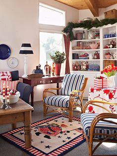 Nautical stripes appear in this living room on everything from upholstery and holiday gift wrap to lampshades and candles. With so much red in the room all year, only small touches of holly and garland are needed to add the Christmas spirit.