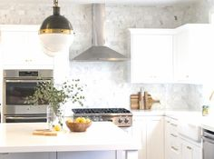 Today, I'm excited to share with you the full details and before and after of my recent Ledgewood project. My goal was to transform the original kitchen from a dark feeling space to an open, bright and fresh new kitchen within a reasonable budget. Take a peek into this black, white and brass kitchen makeover.