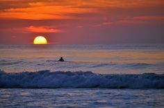 A surfer at sunrise, waiting for  the perfect wave. Monica Murphy.jpg