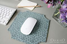 Cover a cheap Office Depot mousepad with fabric using spray adhesive. Simple and cute!