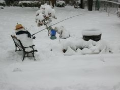 Snowman fishing in the pond...It's so hot outside I miss winter!