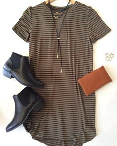 Slip into this olive green, striped t-shirt dress, featuring a crew neck and short sleeves. Pairs well with your favorite booties and a denim jacket.