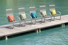 Lana means afloat, calm as still waters, which also defines the soft, relaxing motion you will feel in this new spring base collection. The Spring Base Dining Chair is the perfect fit for conversation around a fire table, paired up on a porch or as a dining option. This outdoor patio chair goes well as part of a patio set, garden furniture, or outdoor furniture.