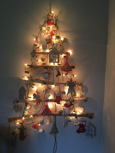 Hanging branch Christmas tree decorated with lights and mostly hand made decorations Light Decorations, Christmas Tree Decorations, Christmas Trees, Holiday Decor, Coming Home For Christmas, Christmas Home, Alternative Christmas Tree, Tree Wall, Tree Branches