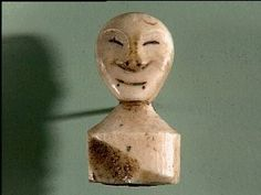 Made in Kuskokwim River, Alaska, USA  Received from Lt. George T. Emmons  What    Name: Carving, Doll's Head (Man's)  Identification Number: 60.1/ 4073  Type of Item: carving  Material: ivory  Overall: length 3.5 cm, width 1.9 cm, height 1.2 cm  Where    Holding Institution: American Museum of Natural History  Made in: Kuskokwim River, Alaska, USA