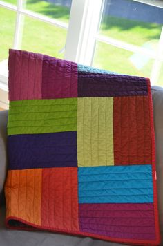 Great color block quilt!  Click to see the fabulous fabric she used on the back and instructions how to make this quilt.