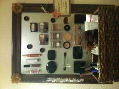 Use a picture frame, basket and prestik and voila - your makeup is organised AND accessible!