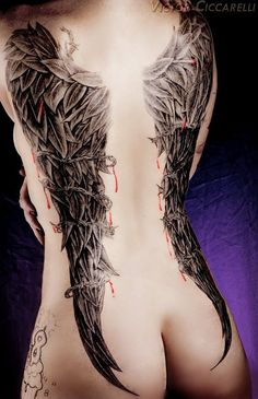 The real shame about getting a great tattoo on one's backside is that they remain under pants. Pants aren't mandatory here, look at these badass tattoos.