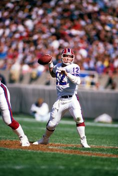 CHICAGO, IL-OCTOBER NFL Hall of Fame quarterback Jim Kelly of the Buffalo Bills gets ready to throw a pass during a game against the Chicago Bears at Soldier Field, Chicago Illinois. Kelly played for the Buffalo Bills from Nfl Football Helmets, Nfl Football Players, Watch Football, Nfl Photos, Football Photos, Nfl Hall Of Fame, Jim Kelly, Buffalo Bills Football, Football Conference