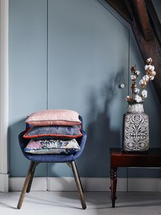 Mood chair designed by René Holten for Artifort covered in POM Amsterdam pillows.