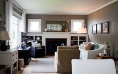 White curtains... Would I dare? Fireplace surround.. Yes!  Mirror over mantel.. Yes!  Should I paint the end tables white?