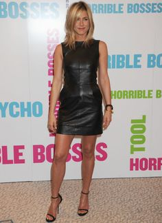 jennifer anniston. black leather mini dress by Celine paired with strappy black Gucci heels.