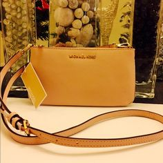 Michael Kors Specchio Brand new with tags 100% authentic slim crossbody ballet color Michael Kors Bags Crossbody Bags