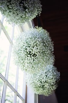 Baby's breath flower balls ... lovely on the eyes and flowers budget! This would be neat to hang from chandeliers!
