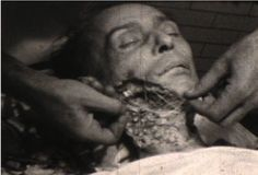 A still from an instructional video showing a mortician recreating the face of a corpse to make him presentable for the funeral, 1938.