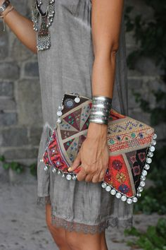 grey dress and colorful purse