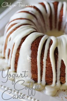 Yogurt Coffee Cake! With a delicious cinnamon streusel layered in and cream cheese frosting!