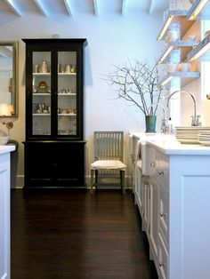 Suzie: Sage Design - Lovely kitchen with black glass-front cabinet, white kitchen cabinets with ...